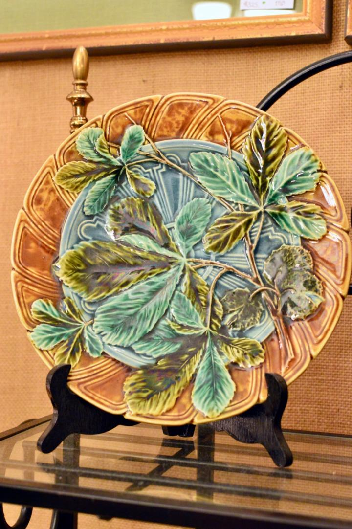 Beautiful mold work & painting Majolica plate. Signed.