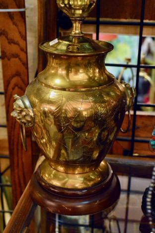 Brass lamp w/ lion heads