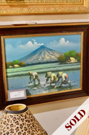 Figures in a rice field with a volcano. Oil on canvas