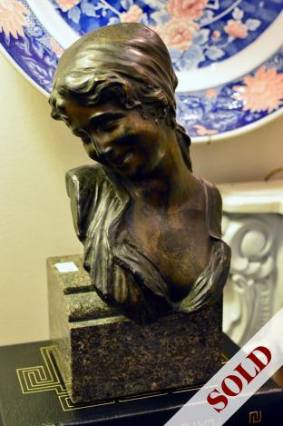 Bronze bust of woman on granite