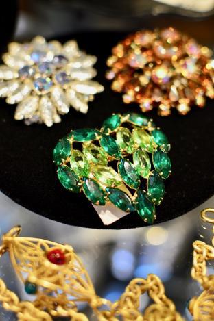 Green rhinestone pin