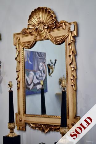 Gilt shell mirror