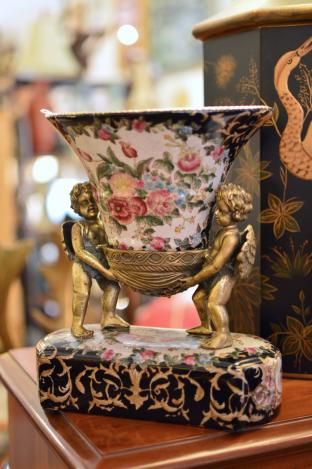 Cupid & floral vase on stand
