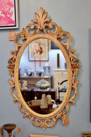 Vintage hand painted oval wood syrocco mirror