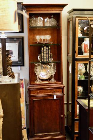 Baker tall walnut display cabinet